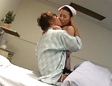 Glamorous Asian nurse moans as she is nailed picture 11