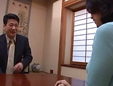 Horny mature Japanese AV Model gets banged in the office picture 6