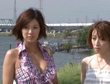 Two stunning MILFs Anje Hoshi, and Nana Satake have a hot threesome outdoors