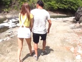 Hot Asian babe gets fucked by a creek in the woods