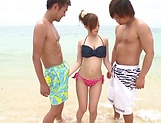Young bikini babe, Rino Kirishima sucks two dicks on the beach picture 2