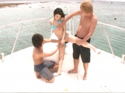 Sweet chick in a blue bikini Nana Nanami fucked by two guys on a boat