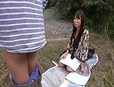 Insolent chick is a horny Japanese AV model giving head outdoors picture 13