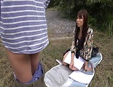 Insolent chick is a horny Japanese AV model giving head outdoors picture 14
