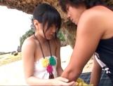 Hot Asian babe Nana Nanami sucks dick at the beach picture 11