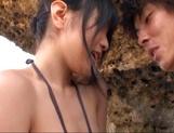 Hot Asian babe Nana Nanami sucks dick at the beach picture 13