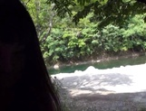 Gorgeous Asian babe sucks dick and eats sperm outdoors