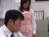 Sexy office lady Rino Kamiya gives a blowjob and gets rear fuck picture 3
