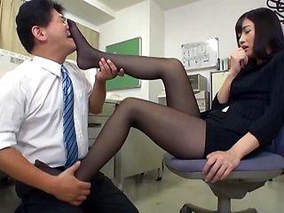 Horny Japanese office lady Rina Fukada gives incredible footjob