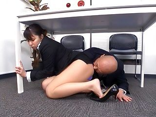 Horny office lady fucks her horny boss under the table