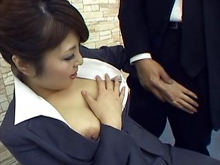 Hot office milf with lovely tits gives a kinky blowjob