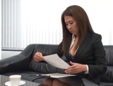 Sexy Asian office girl blowing a large penis