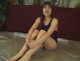 Juicy Japanese teen, Hikaru Hinata, in dark swimsuit gets oiled enjoys toy insertion picture 12