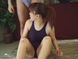 Juicy Japanese teen, Hikaru Hinata, in dark swimsuit gets oiled enjoys toy insertion picture 14