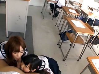 Mischievous Japanese schoolgirls share and suck one hard dick