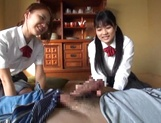 Two naughty Japanese schoolgirls share cock and ride it passionately picture 12