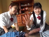 Two naughty Japanese schoolgirls share cock and ride it passionately picture 14