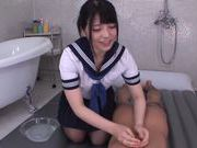 Horny Asian gal Ai Uehara gives a footjob and bounces on rod