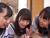 Three hot schoolgirls give head and a tit fuck