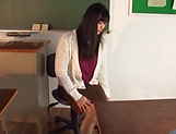Hirose Yoko giving her student a worthy footjob picture 2