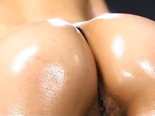 Hot babe Aki Nagashima shows off her big tits and ass