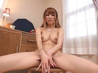 Pretty Asian redhead Rua Natsuki shows off her body and sucks cock