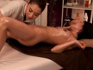 Horny milf gets her sexy body oiled and massaged by a lesbian masseuse
