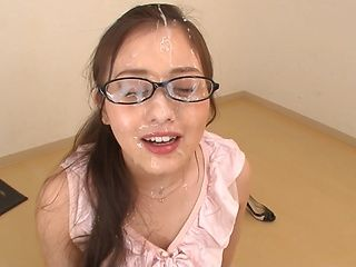 Japanese teacher Minami Kojima sucks two cocks in harsh manners