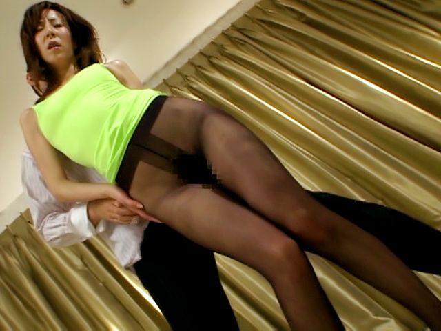 Curvy Asian MILF Reiko Sawamura teases in sexy stockings