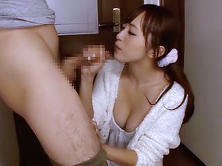 Horny milf Yuu Namiki gives a footjob and sucks long cock