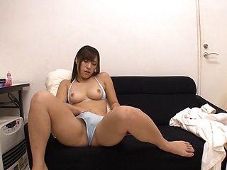 Sexy MILF Kumi Nagano masturbates vigorously on a sofa