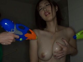 Asahi Mizuno gets teased by two horny guys with water guns in a bathroom