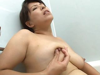 Naughty mature Nozomi Sasayama finger fucks herself in the bathtub