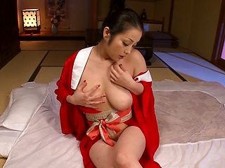 Horny Asian MILF, Minako Komukai, fucks herself with a big toy