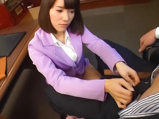 Naughty Japanese AV model is a sexy teacher giving a foot job