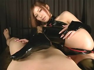 Exquisite Japanese sex model Yuna Shiina gives a footjob and sucks