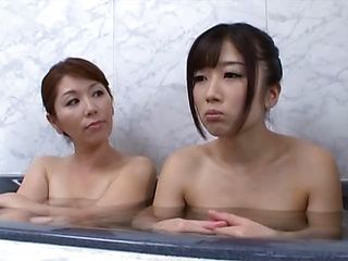 Arousing Asian lesbian is in the bath with her lover