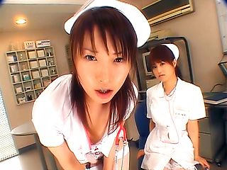 Two hot nurses give handjobs to their patients
