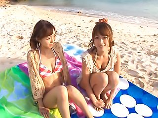 Aino Kishi and her horny Asian girlfriends in group action on the beach