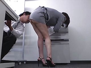 Naughty Japanese office lady shows off perfect ass in upskirt shots