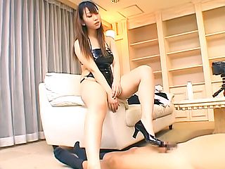 Naughty Japanese office lady, Ai Sayama gives footjob, gets cumshot