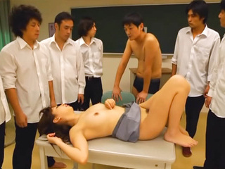 Naughty Asian teacher Shoko Akiyama is a hot milf in class gangbang