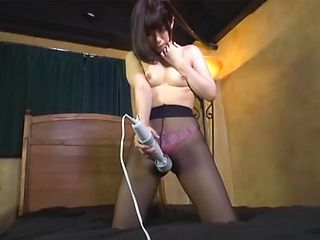 Lovely Japanese girl in black nylon pantyhose is a fan of vibrators