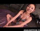 Peachy Asian milf in tiger bikini Karin Tsubaki on Asian anal porn picture 1