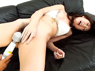 Asian chick with hairy muff Ren Asano enjoys pussy and anal rubbing