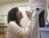 Sexy teacher Kanari Tsubaki does hand work on hard cock