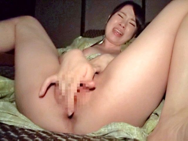 Riko Komori stroking her tight vagina in masturbation