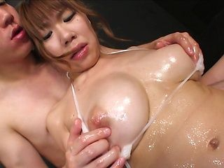 Oiled Asian milf with big boobs Iroha Suzumura bounces on boner