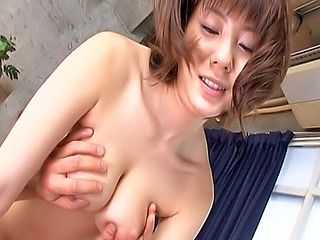 Yuma Asami Busty Asian model enjoys showing off her big boobs