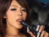 Rukia Mochizuki Asian model pokes her pussy with a dildo